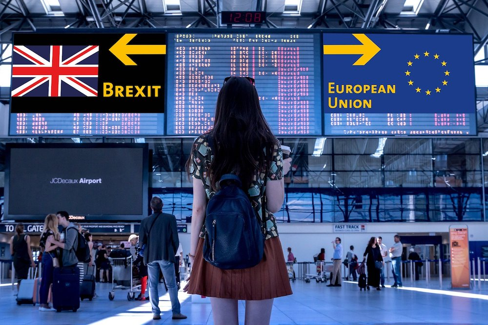 woman at airport looking at Brexit signs